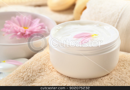 Soft Lotion stock photo, Soft body, hand and face cream with pink petals on top in a bathroom/spa setting (Selective Focus, Focus on the horizontal/back petal on the cream) by Ildi Papp