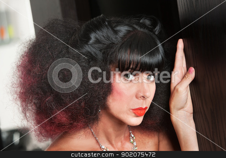 White Woman with Frizzy Hair stock photo, Pretty European woman with afro haircut inside hair salon by Scott Griessel