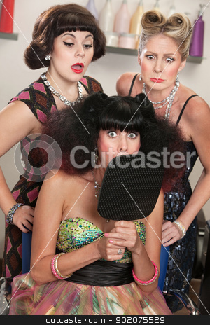 Wide Eyed Lady in Hair Salon stock photo, Shocked woman behind mirror with curious ladies in hair salon by Scott Griessel
