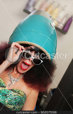 Lady Under Hair Dryer Shouting stock photo, Shouting Caucasian with frizzy hair in large hair dryer by Scott Griessel