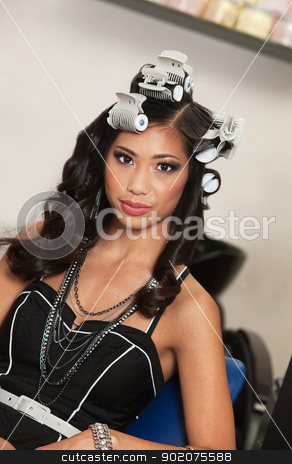 Calm Woman with Curlers stock photo, Gorgeous young Asian female with hair curlers by Scott Griessel