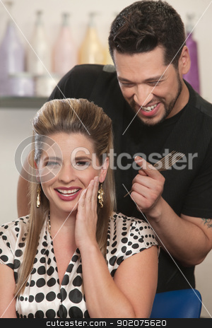 Blushing Lady with Hair Stylist stock photo, Cute Arab hair stylist admiring woman's haircut by Scott Griessel