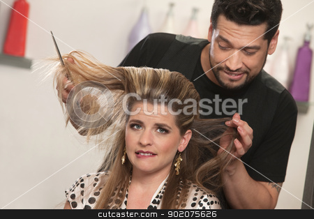 Lady with Hair Problem stock photo, White female biting lip with embarrassed hair stylist by Scott Griessel