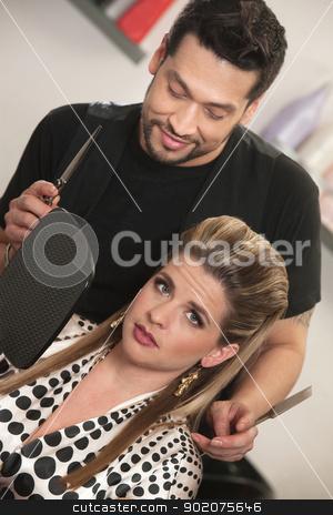 Hairdresser With Annoyed Customer stock photo, Hairdresser holding mirror for annoyed European customer by Scott Griessel