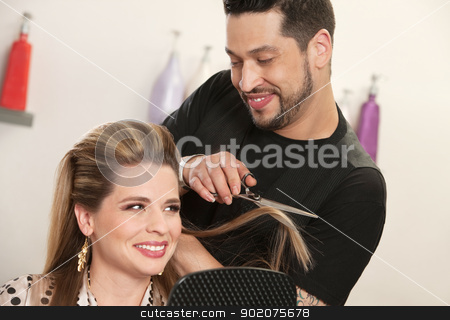 Attractive Woman Getting Haircut stock photo, Gorgeous woman getting haircut by attractive Arab hairdresser by Scott Griessel