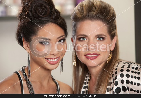 Mixed Pair of Gorgeous Ladies stock photo, Pair of gorgeous Asian and White young women by Scott Griessel