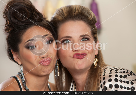 Ladies Making Faces stock photo, Asian and European pair of women making faces by Scott Griessel