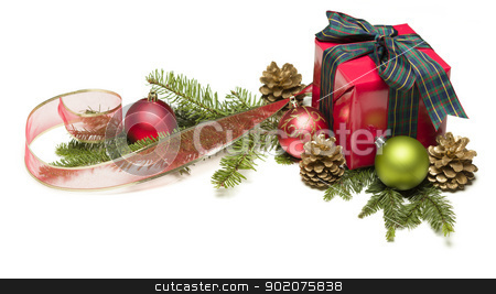 Christmas Present with Ribbon, Pine Cones and Ornaments stock photo, Christmas Present with Ribbon, Pine Cones, Ornaments and Pine Branches Isolated  on a White Background. by Andy Dean