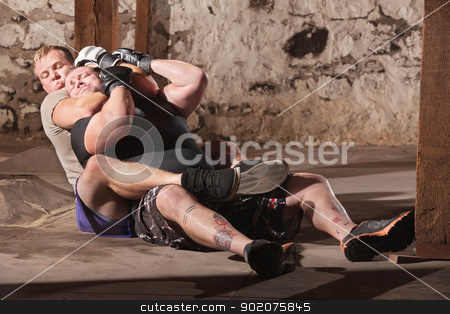 MMA Fighters in Choke Hold Training stock photo, Two men training in rear choke holds by Scott Griessel