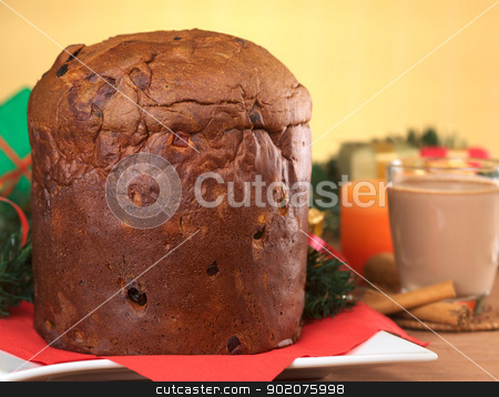 Panettone stock photo, Panettone is a traditional Christmas cake, which is originally from Italy, but is enjoyed now also in many South American countries (Selective Focus, Focus on the front of the cake)  by Ildi Papp