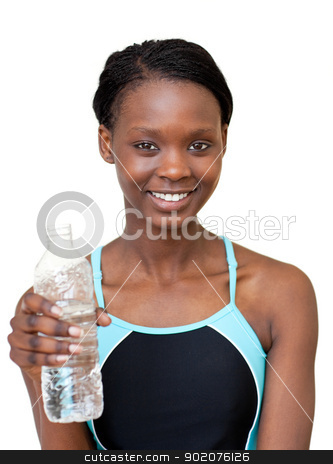 Smiling woman holding a bottle of water stock photo, Smiling woman holding a bottle of water against a white background by Wavebreak Media