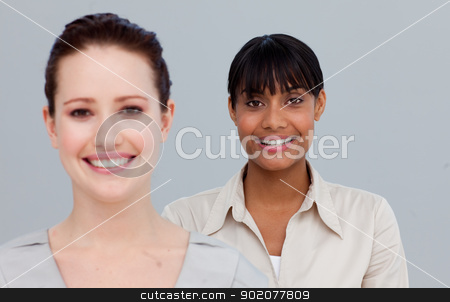 Portrait of smiling businesswomen stock photo, Portrait of two beautiful businesswomen smiling at the camera by Wavebreak Media