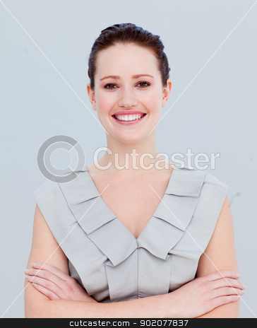 Portrait of a smiling beautiful businesswoman with folded arms stock photo, Portrait of a beautiful businesswoman with folded arms smiling at the camera by Wavebreak Media