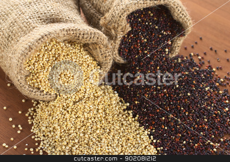 Quinoa stock photo, Raw red and white quinoa grains in jute sack on wood. Quinoa is grown in the Andes region  and has a high protein content and a high nutritional value (Selective Focus, Focus on the white quinoa grains at the sack opening running through to the right corner) by Ildiko Papp