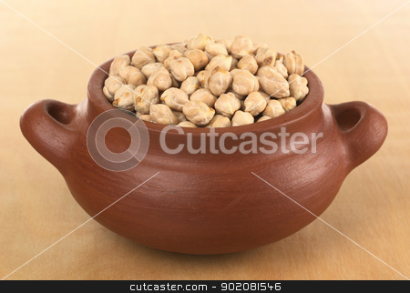 Chickpea stock photo, Raw white dried chickpeas (lat. Cicer arietinum) in rustic bowl on wood (Selective Focus, Focus on the first half of the chickpeas) by Ildiko Papp
