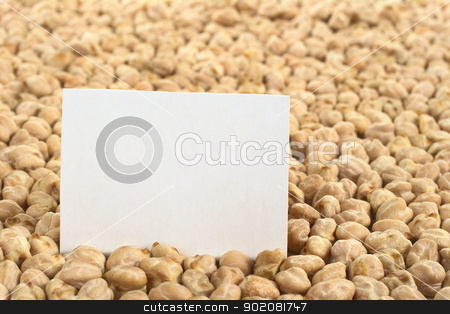 Chickpeas with Card stock photo, Raw white dried chickpeas (lat. Cicer arietinum) with a blank card (Selective Focus, Focus on the card) by Ildiko Papp