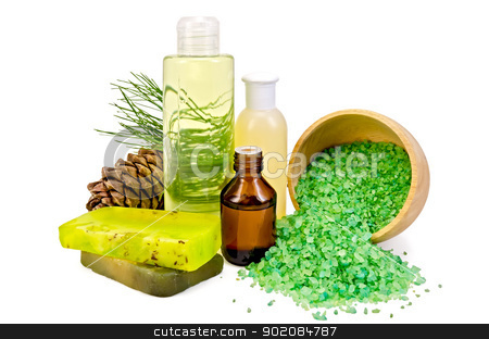 Oil with toiletries and cedar cones stock photo, Cedar oil in a bottle, cedar cones with branch, two green homemade soap, salt in a wooden bowl, lotion, shower gel isolated on white background by rezkrr
