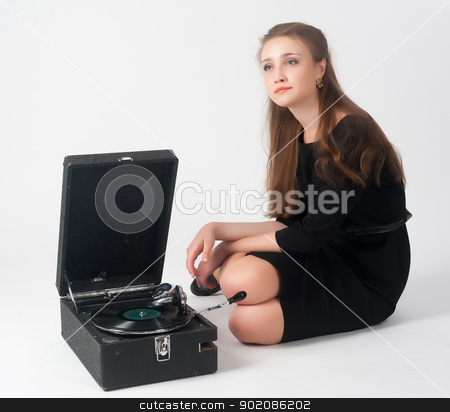 Pretty woman with gramophone stock photo, Beautiful woman with gramophone. Isolated on white by Aikon