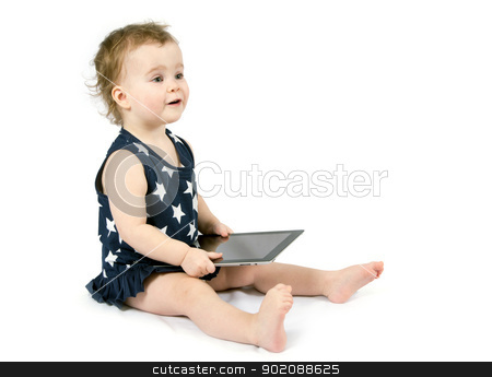 Baby playing with tablet stock photo, Baby girl playing with tablet by Vitaliy Pakhnyushchyy