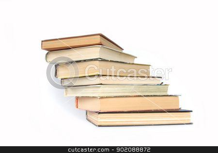 books stock photo, Pile of books on a grey background by Vitaliy Pakhnyushchyy