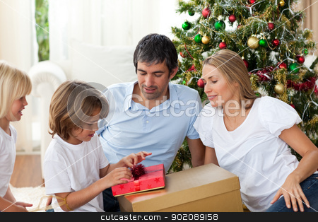 Cheerful family celebrating Christmas stock photo, Cheerful family celebrating Christmas at home by Wavebreak Media