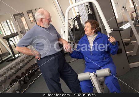 Senior Adult Couple Working Out Together in the Gym stock photo, Active Senior Adult Couple Working Out Together in the Gym. by Andy Dean