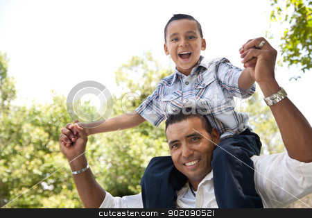 Hispanic Father and Son Having Fun in the Park stock photo, Hispanic Father and Son Having Fun Together in the Park. by Andy Dean
