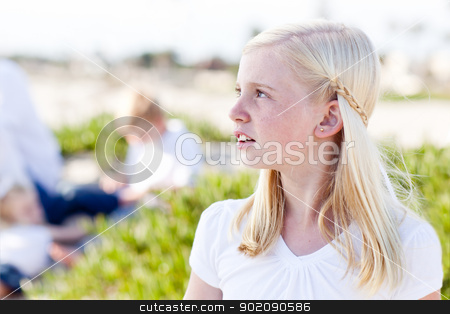 Adorable Little Blonde Girl Having Fun At the Beach stock photo, Adorable Little Blonde Girl Having Fun At the Beach with Her Family. by Andy Dean