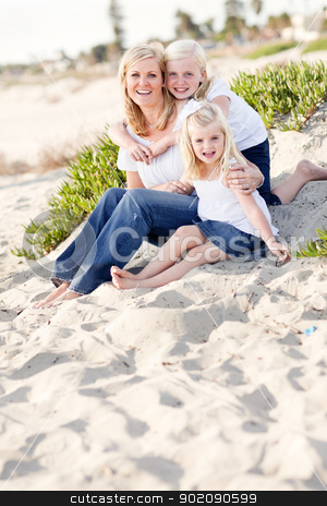 Pretty Mom and Her Cute Daughters at The Beach stock photo, Pretty Mom and Her Cute Daughters Portrait at The Beach. by Andy Dean