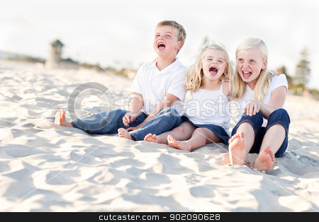 Cute Sibling Children Sitting at the Beach stock photo, Adorable Sibling Children Portrait at the Beach. by Andy Dean