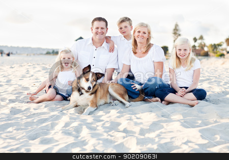 Happy Caucasian Family Portrait at the Beach stock photo, Happy Caucasian Family and Their Dog Portrait at the Beach. by Andy Dean