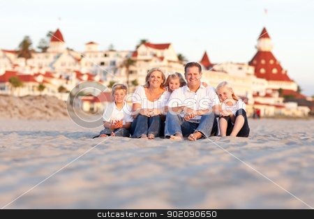 Happy Caucasian Family in Front of Hotel Del Coronado stock photo, Happy Caucasian Family in Front of Hotel Del Coronado, U.S.A. on a Sunny Afternoon. by Andy Dean