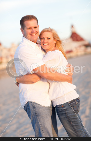 Attractive Caucasian Couple Hugging at the Beach stock photo, Attractive Caucasian Couple Hugging at the Beach in Front of the Hotel Del Coronado, San Diego, CA. by Andy Dean