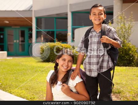 Cute Hispanic Brother and Sister Ready for School stock photo, Cute Hispanic Brother and Sister Wearing Backpacks Ready for School. by Andy Dean