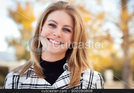 Pretty Young Woman Smiling in the Park stock photo, Pretty Young Woman Smiling in the Park on a Fall Day. by Andy Dean