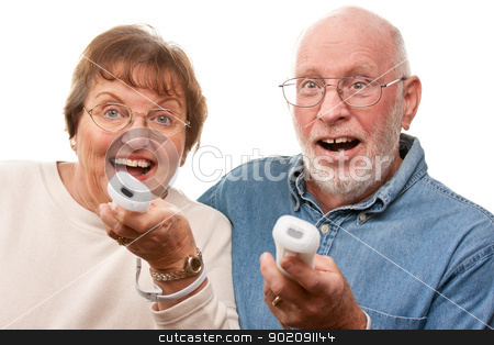 Happy Senior Couple Play Video Game with Remotes stock photo, Happy Senior Couple Play Video Game with Remote Controls On a White Background. by Andy Dean