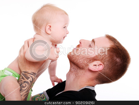 Happy baby in father hands stock photo, Happy baby in strong father hands by yekostock