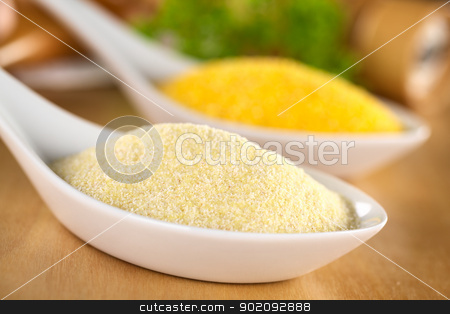 Raw Semolina stock photo, Raw semolina with ground corn in the back (Selective Focus, Focus one third into the semolina)  by Ildiko Papp