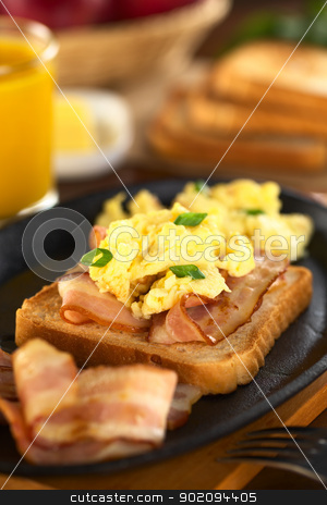 Fried Bacon and Scrambled Eggs on Toast Bread stock photo, Fried bacon and scrambled egg on toast bread (Selective Focus, Focus on the front of the shallot in the front)  by Ildi Papp