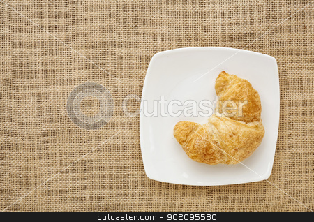 croissant roll  stock photo, croissant roll on a white china plate against burlap canvas board by Marek Uliasz