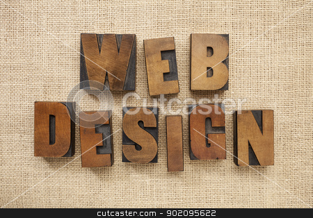 web design in wood type blocks stock photo, web design - text in vintage letterpress metal type blocks on burlap canvas by Marek Uliasz