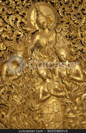buddhist religious figures on temple in laos stock photo, buddhist religious figures on temple in luang prabang laos by travelphotography