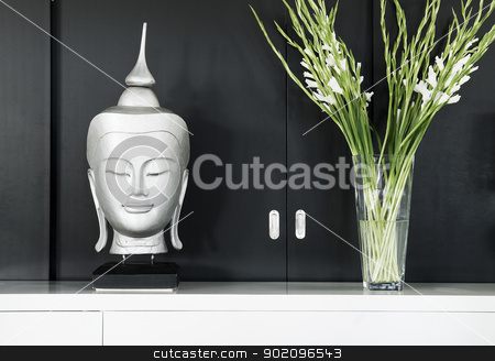 contemporary interior design detail with buddha image and flower stock photo, contemporary interior design detail with buddha image and flowers by travelphotography