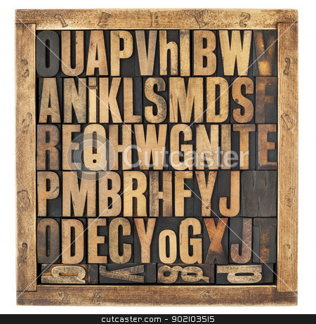 vintage alphabet letters stock photo, random letters of alphabet - vintage letterpress wood type blocks in rustic box isolated on white by Marek Uliasz