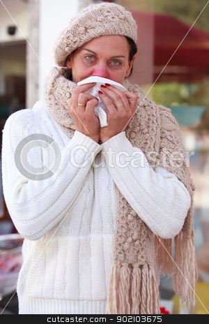 Elderly woman with a cold stock photo, Elderly woman with a cold blows her nose by Roland Stollner
