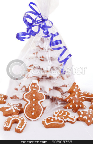 christmas gingerbreads tree on white background stock photo, homemade christmas gingerbreads tree with blue ribbon on white background by Artush