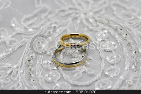 Wedding rings stock photo, Wedding rings, pearls and tulle fabric by Nneirda