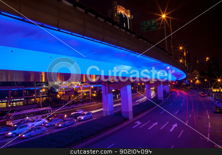 Blue Highway Street Traffic Night Light Trails Central Shanghai  stock photo, Blue Highway Street Traffic Cars and Light Trails at Night in Central Shanghai, China.  by William Perry