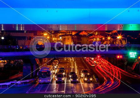 Blue Highway Street Traffic Red Night Light Trails Jingan Temple stock photo, Blue Highway Street Traffic Cars and Light Trails Jingan Temple at Night in Central Shanghai, China.  by William Perry
