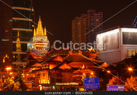 Golden Jing An Temple Park Nanjing Street Shanghai China at Nigh stock photo, Golden Temples Roof Top Jing An Tranquility TempleCentral Shanghai, China. Richest buddhist temple in Shanghai at Night.  Trademarks removed or obscured. by William Perry